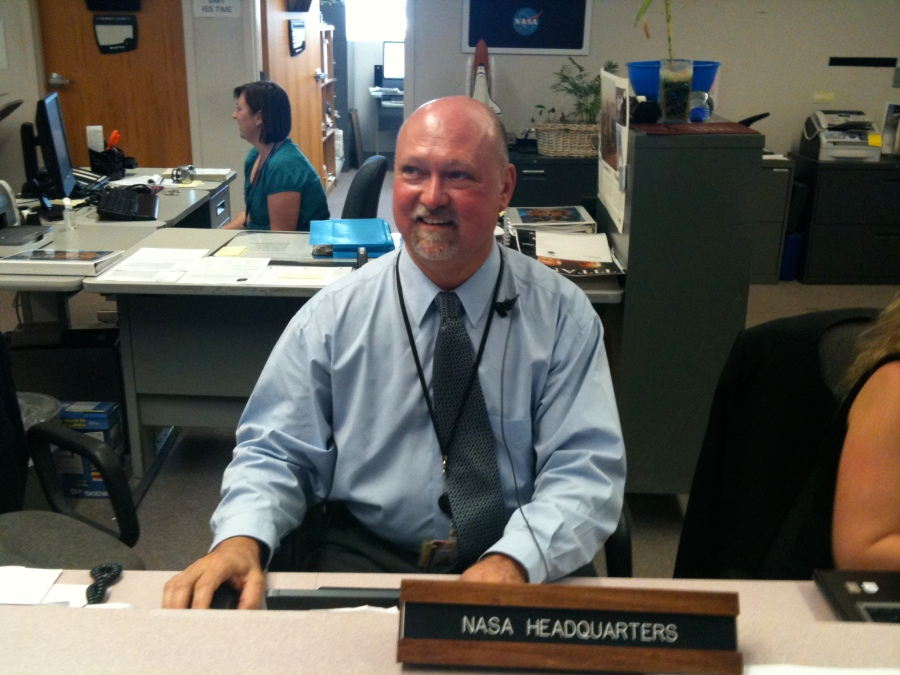 Mike Curie at Press desk