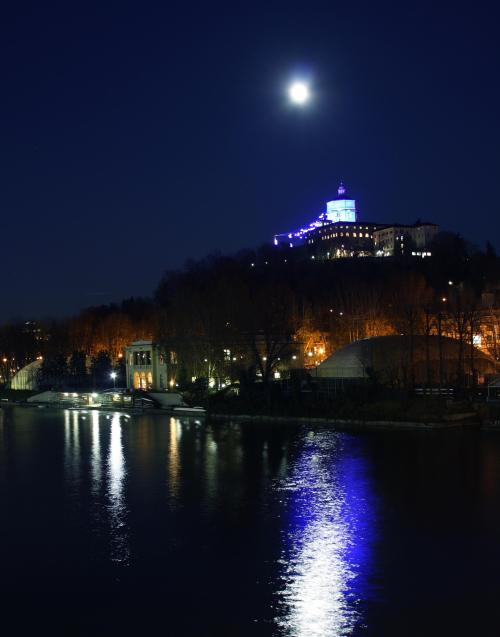 Not a blue moon. Full moon over River Po, in Turin, Italy