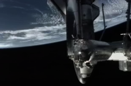 Shuttle docked at Space Station 220 miles over Earth