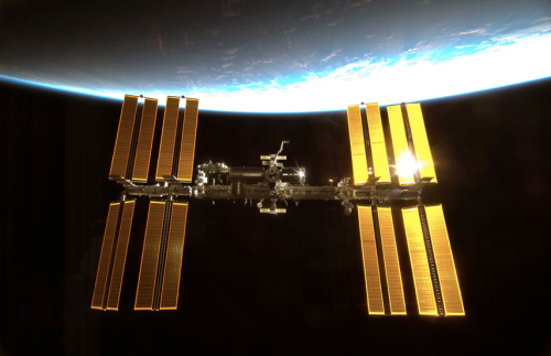 Sun glints off Space Station solar arrays. Credit:NASA
