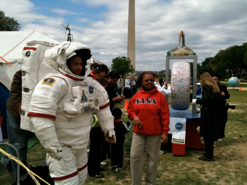 NASA's Vickie Walton staffs Photo Op Spacesuit.
