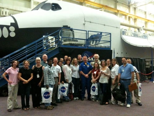 Tweeps with Astronaut Steve Robinson in front of Shuttle mockup.