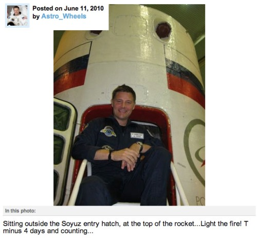 @Astro_Wheels posing next to Soyuz Hatch