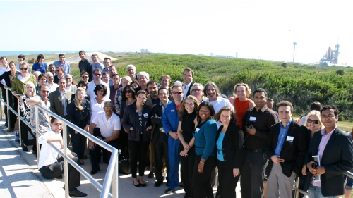 LAUNCH:Health Group Portrait with Space Shuttle Discovery
