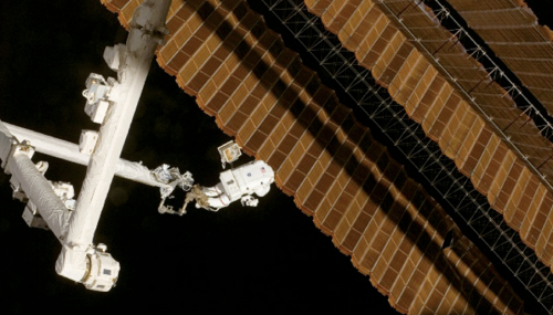 Scott Parazynski repairing Space Station solar array: Credit: NASA