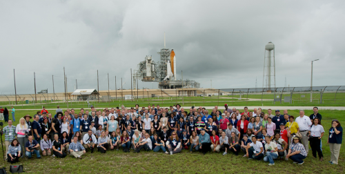 STS-135 space tweeps in front of Atlantis on Launchpad