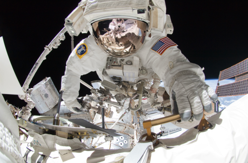 Astronauts Mike Fincke reflected in Greg Chamitoff's visor. Final spacewalk by Space Shuttle crew.