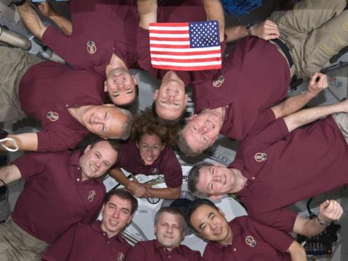 STS-135 final mission to Space Station with US flag flown on STS-1.