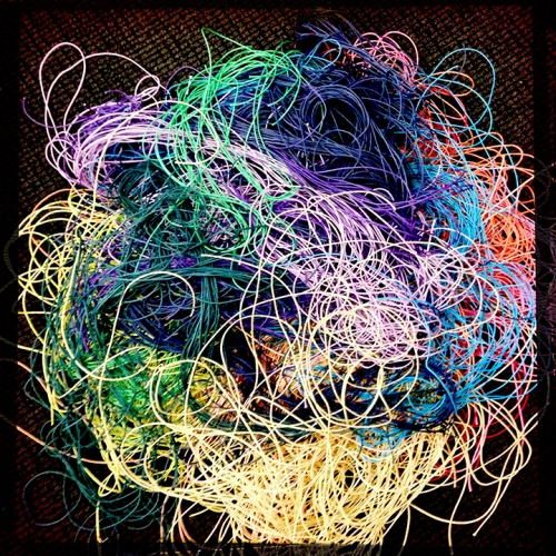 Tangled fibers represent threads of future knowledge.