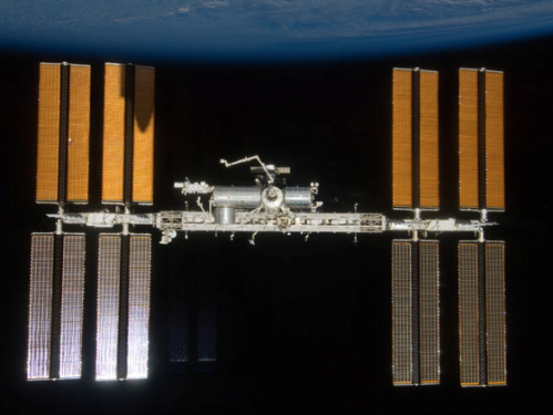 Space Station 2009 (Can you find Endeavour's shadow?)