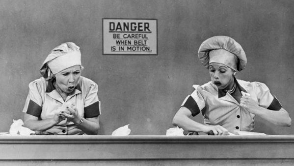 I Love Lucy: Candy Factory Episode with Lucy and Ethel trying to keep up with the conveyor belt.